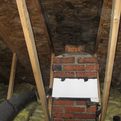 Pulling a permit doesn't guarantee that everything is correct. The builder added a second story to this rambler, BUT, forgot to extend the chimney through the roof! The chimney terminates in the attic. Notice the blackened plywood from the gas furnace
