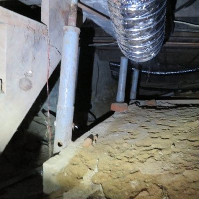 The structural posts in the crawl space are leaning, one already fell. THIS IS THE MAIN HOUSE BEAM SUPPORT!