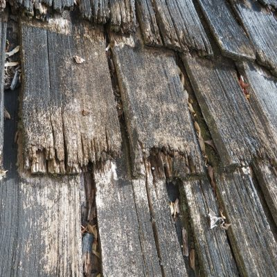 Very expensive wood shingles are completely worn out