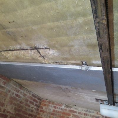Why is this concrete garage ceiling leaking water?